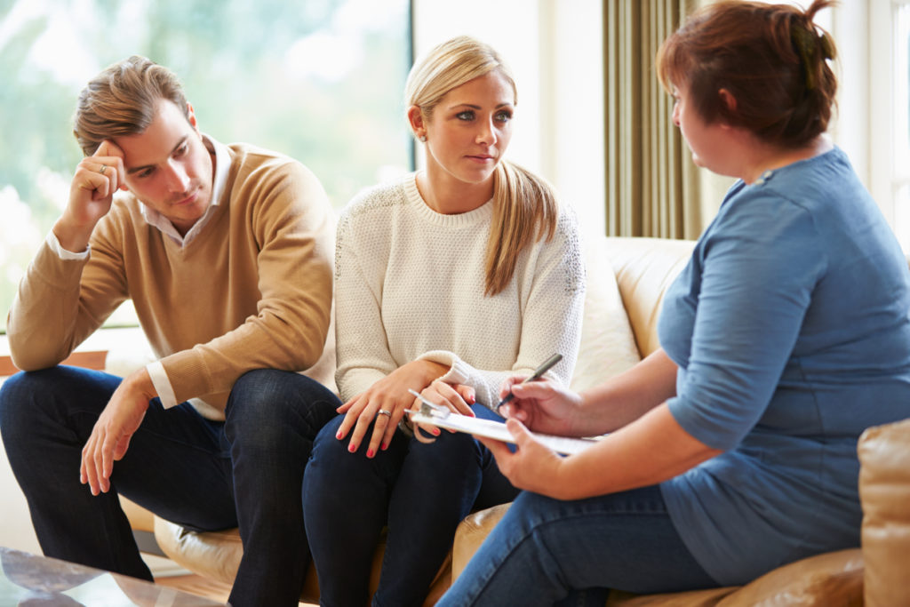 Counselor Advising Upset & Stressed Couple On Relationship Difficulties